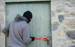 Burglar Breaking Into a Property